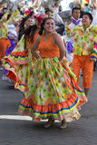Female dancer group wearing colourful dresses in Ecuador. June 17, 2017 Pujili, Ecuador: female dancer group in traditional clothing in motion at the Corpus royalty free stock photos