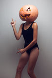 Female dancer with halloweens pumpkin Stock Photography
