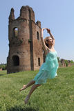 Female dancer outdoors, interpreting ruins of Circus Maxentius, Royalty Free Stock Images