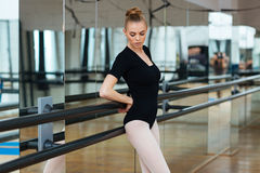Female dancer resting in ballet class Stock Photos