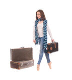 Female dancer with retro suitcases. Female dancer on tiptoe with retro suitcases isolated on white background Stock Images