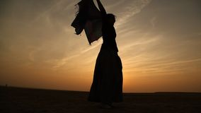Female dancer silhouette in Sun set stock footage