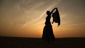 Female dancer silhouette in Sun set stock footage
