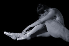 Female dancer sit on floor looking sad in artistic conversion Royalty Free Stock Photos