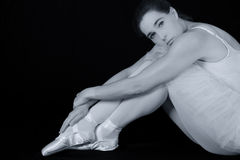 Female dancer sit on floor looking sad in artistic conversion. Black and white Royalty Free Stock Images