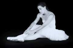Female dancer sit on floor looking sad. In artistic conversion black and white Stock Image