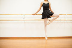 Female dancer standing on her toes Stock Images