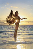 Female dancer standing in the ocean Stock Photo