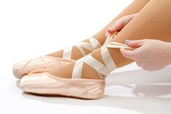 Tying Ballet Slippers Royalty Free Stock Images