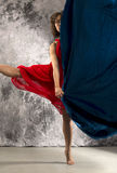 Female dancer in a turn with dark blue fabric. Royalty Free Stock Photo