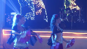 Female dancers dancing in spanish costume at indian wedding party stock video footage