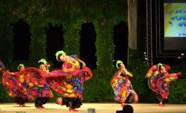 Female dancers vivid dresses Royalty Free Stock Image