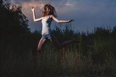 Female dancing in a evening Stock Images
