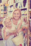 Female with daughter choosing bread Stock Images
