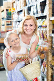 Female with daughter choosing bread Royalty Free Stock Image