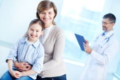 Female with daughter in hospital Royalty Free Stock Photos