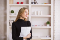 Female daydreaming in office Stock Image