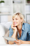 Female daydreaming Stock Images
