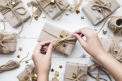 Female decorating christmas presents gift box.collection in vintage Stock Photography