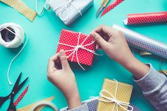 Female decorating cute gift box presents on worktable. Background.For christmas,new year,birthday and happiness concepts ideas Stock Image