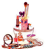 Female decoration Makeup Brushes Ladies. Composition of inanimate objects, cosmetics, powder, paint, female curlers several brushes, lipstick for applying makeup Royalty Free Stock Photography