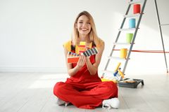 Female decorator with color palette. Indoors royalty free stock photos