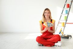 Female decorator with color palette. Indoors royalty free stock photo