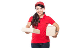 Female delivery service happily delivering package to costumer Royalty Free Stock Image