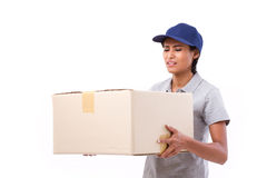 Female delivery staff carrying heavy parcel carton box. White isolated background Royalty Free Stock Photography