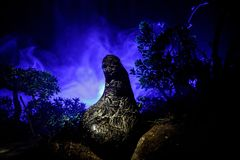Female demon. Demons coming. Slhouette of devil or monster figure on a background of fire. Horror view. Horror silhouette of scary figure in forest at night Royalty Free Stock Photography