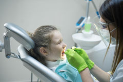 Female Dentist checking little girl patient Royalty Free Stock Images