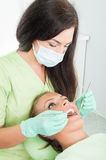 Female dentist checking oral hygiene Royalty Free Stock Photography