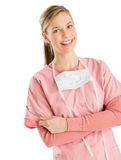 Female Dentist With Dental Equipments Standing Arms Crossed Royalty Free Stock Photography