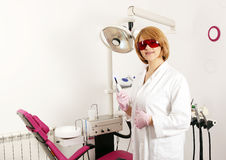 Female dentist with in dental office Royalty Free Stock Image