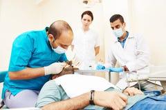 Female dentist doctor teaching students stock photos