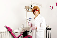 Female dentist with equipment Stock Photos