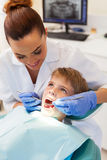 Female dentist examining patient Stock Photo