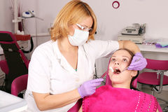Female dentist and girl patient Royalty Free Stock Image