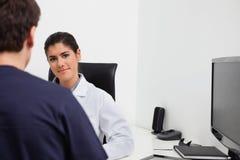 Female dentist at her desk Stock Photos