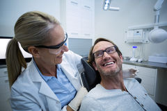 Female dentist interacting with male patient Royalty Free Stock Photos