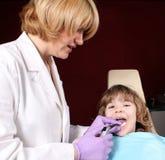 Female dentist and little girl Stock Images