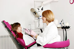 Female dentist and little girl patient Royalty Free Stock Photography