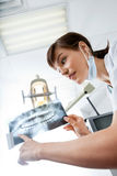Female Dentist Looking At X-Ray Image Royalty Free Stock Photo
