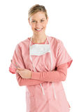 Female Dentist With Mirror And Probe Standing Arms Crossed Royalty Free Stock Images