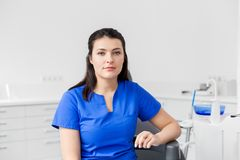 Female dentist or nurse at dental clinic office. Dentistry, medicine and healthcare concept - female dentist or nurse at dental clinic office Royalty Free Stock Photography