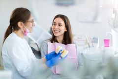 Dentist and patient in dentist office Stock Images