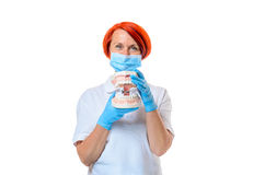 Female dentist with red hair demonstrates teeth Stock Image