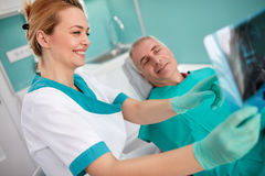 Female dentist show problem with teeth on dental X-ray Stock Photography
