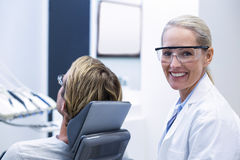 Female dentist smiling Royalty Free Stock Photo