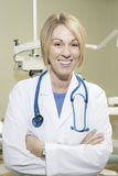 Female Dentist With Stethoscope In Clinic Stock Photography